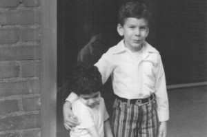 My brother Eddie and me in front of our apartment building, about 1972